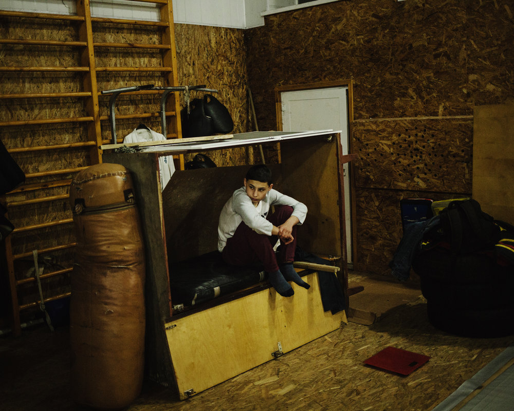 Ceadir-Lunga - A young boy waits for the be- ginning of the boxing lesson.