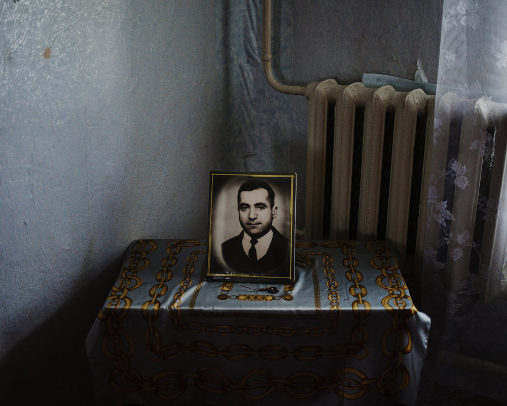 Avdarma - The portrait of a dead man in his wife's house.