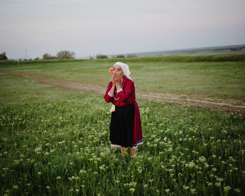 "Besalma - Vasilissa Kease is a member of a tra- ditional folk group who sing old songs and ""perform"" Gagauz traditions as on this photo (washing face in the dew the morning of Hederlez)"