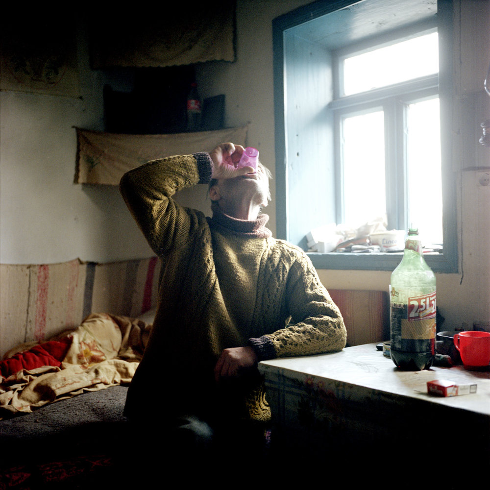 In the village of Cardon, Mihai, a fisherman, is drinking homemade wine.
