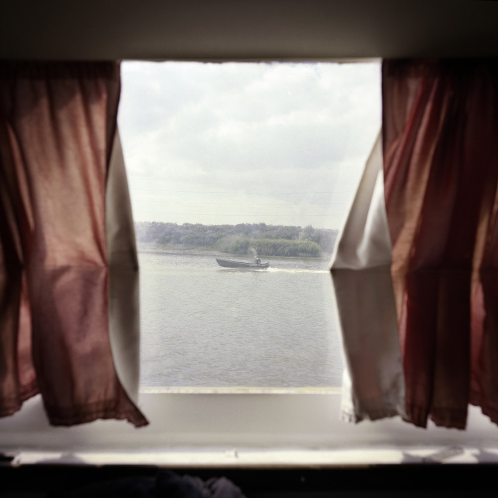 View from the inside of the boat that links up Sulina to Tulcea via the Danube.