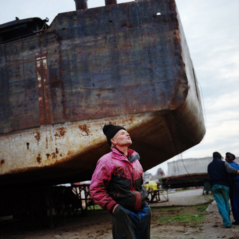 The last workers of the construction are cutting up some old boats to sell the steel. They were thousands workers in the past. Today the construction is updating in order to restart its activities.