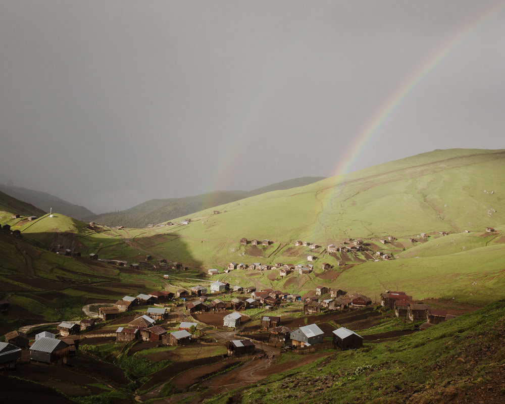 A rainbow after the storm. Zortikheli is the mountain pasture village of the inhabitants of Ghorjomi. A big part of the men and some families come here for a few monthes with their cattles. They have everything here: shop, school, etc