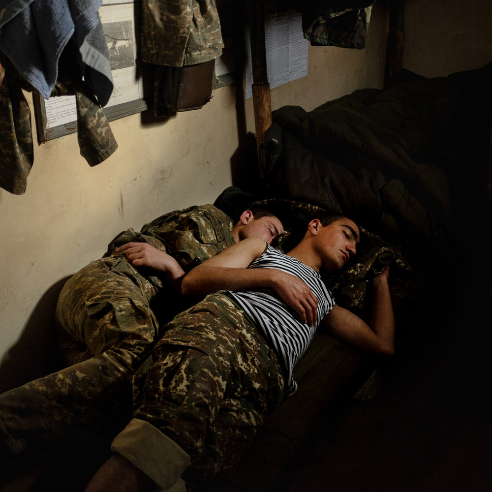 Two young soldiers having rest on the contact line