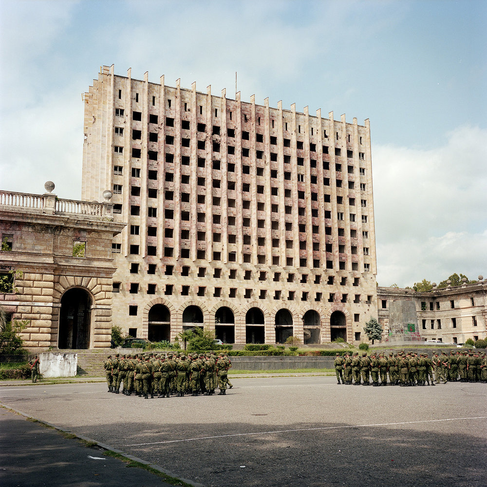 The parade rehearsal of twenty years of Abkhazia's independence take place in front of the former parliament of Sukhum(i) which was occupied and burnt by Georgians during the war.