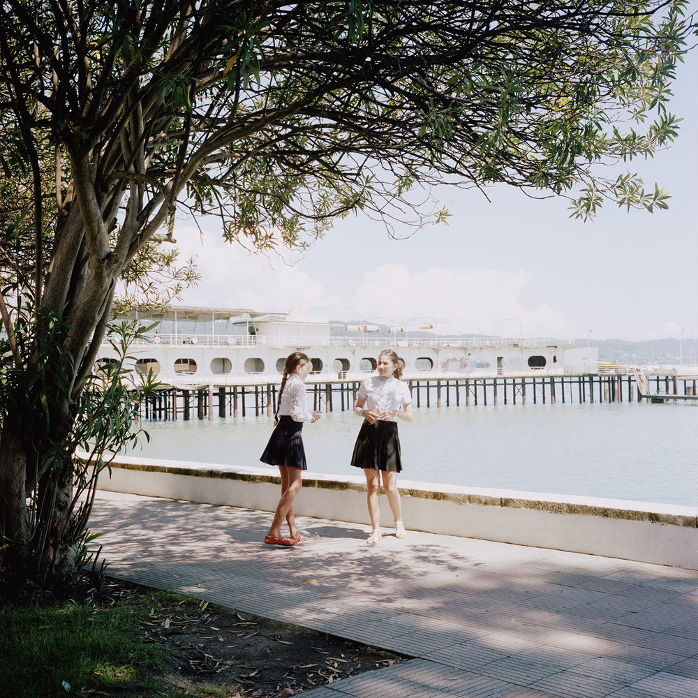 Two young girls along the seaside in Sukhum(i). They are celebrating the last day of school.