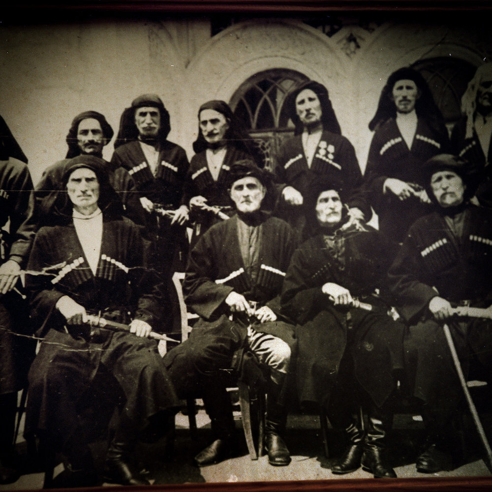 A detail of an old photo of a traditional Abkhaz family.