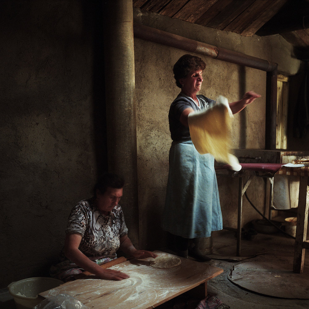 Asya (right) cooks lavash with her neighbor Venera (left). The 3 daughters of Asya are married to men working in Russia. Her young son Artashes studies economics and works every summer in Russia. Once he finishes his studies, he intends to work in Russia.