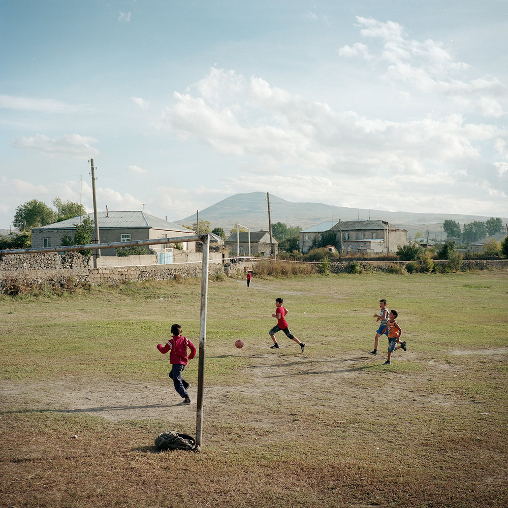 The football field of the village. There are no sports club in Lichk except boxing for boys and dance for girls, but children improvise games.