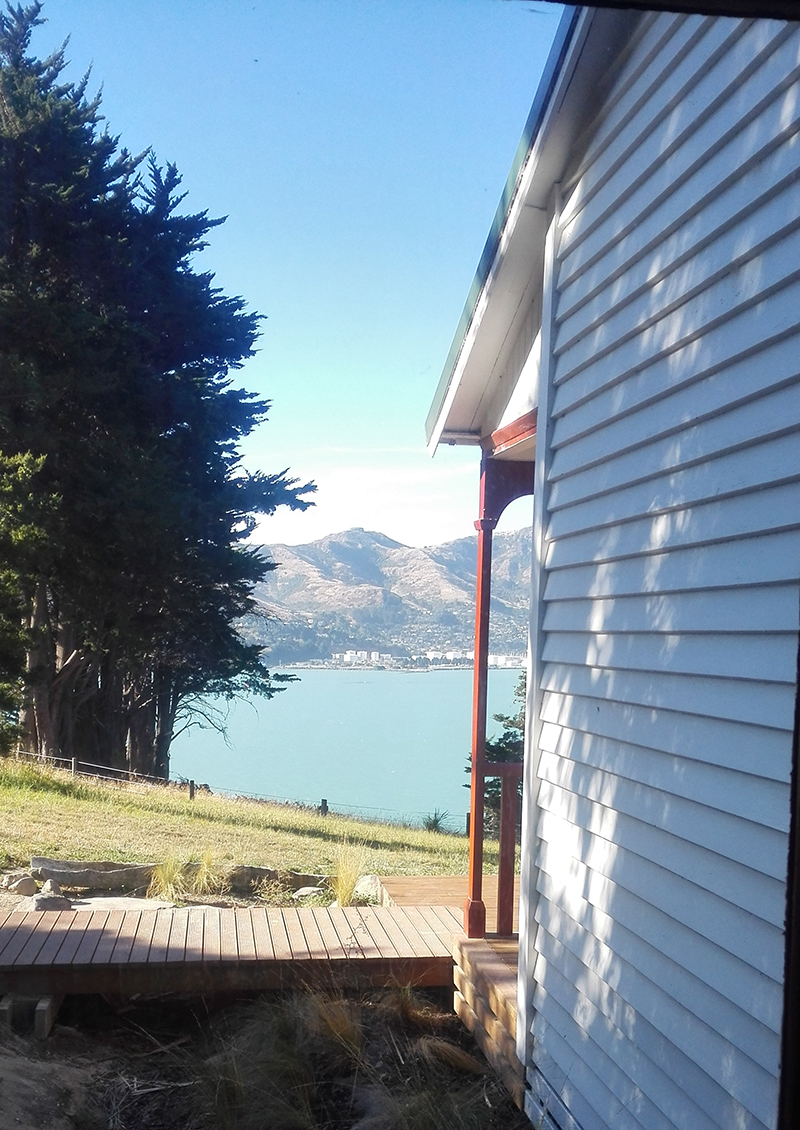 View of Lyttelton from the bunk room (each room has 6 bunks). Our house is behind the large white oil tanks on the left.