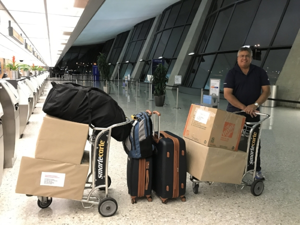 Melvin with the first load of aid (October 2017) including water filtration systems, food, flashlights and batteries, satellite phones, and more...