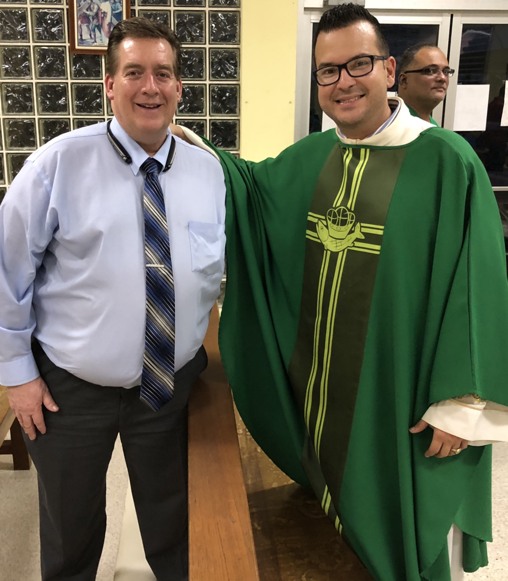 Rich Youngblood, Faith-Based Initiatives PM for HUD poses for a photo with Dr. Orlando Lugo, a Catholic Priest that leads the local parish. The church was established to have a positive impact in the neighborhood and it has, no longer there are gangs in the neighborhood, but there is a need for economic recovery. Rich attended a mass service and Father Orlando encouraged the community members to provide feedback to Rich to take to DC.