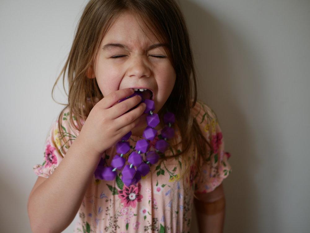 Olive enjoying her new sensory chew from @sensorbility.