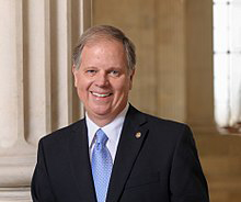 220px-Senator_Doug_Jones2_official_photo.jpg