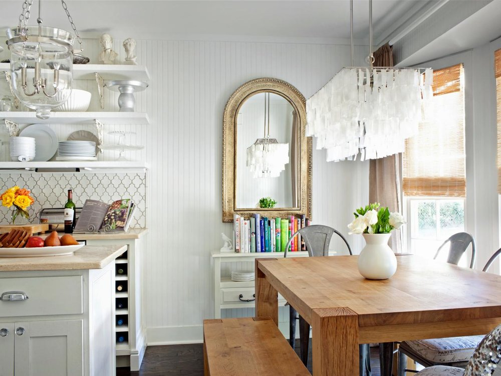 Cottage kitchens - Cozy, happy and unpretentious, a cottage kitchen harks back to simpler times and evokes a sense of easy, carefree living. Beadboard, soft colors, vintage hardware, wood floors and colorful accents and curtains will infuse your kitchen with cottage comfort.