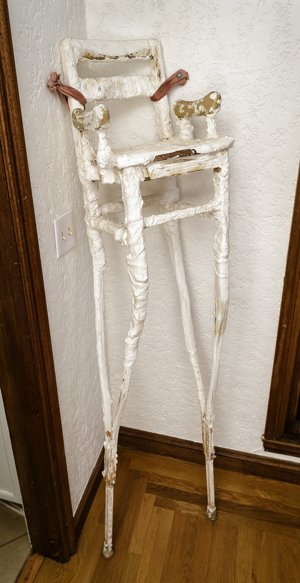 """sitting pretty  wood, plaster and found objects  14""""w x 70""""h x 16""""d  6,000.00"""