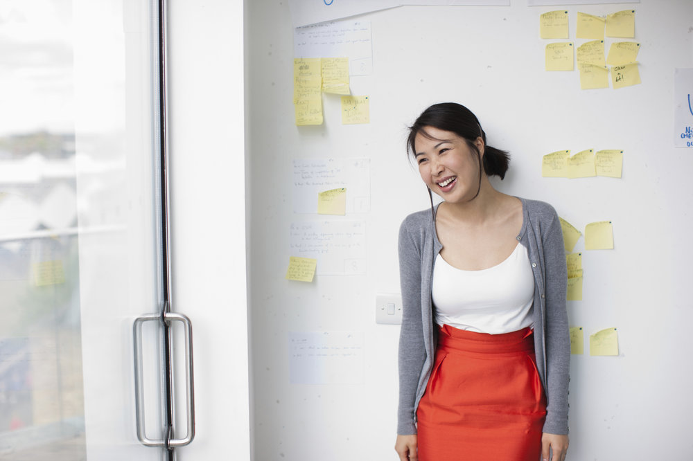 asian woan with post it notes and workshop.jpg