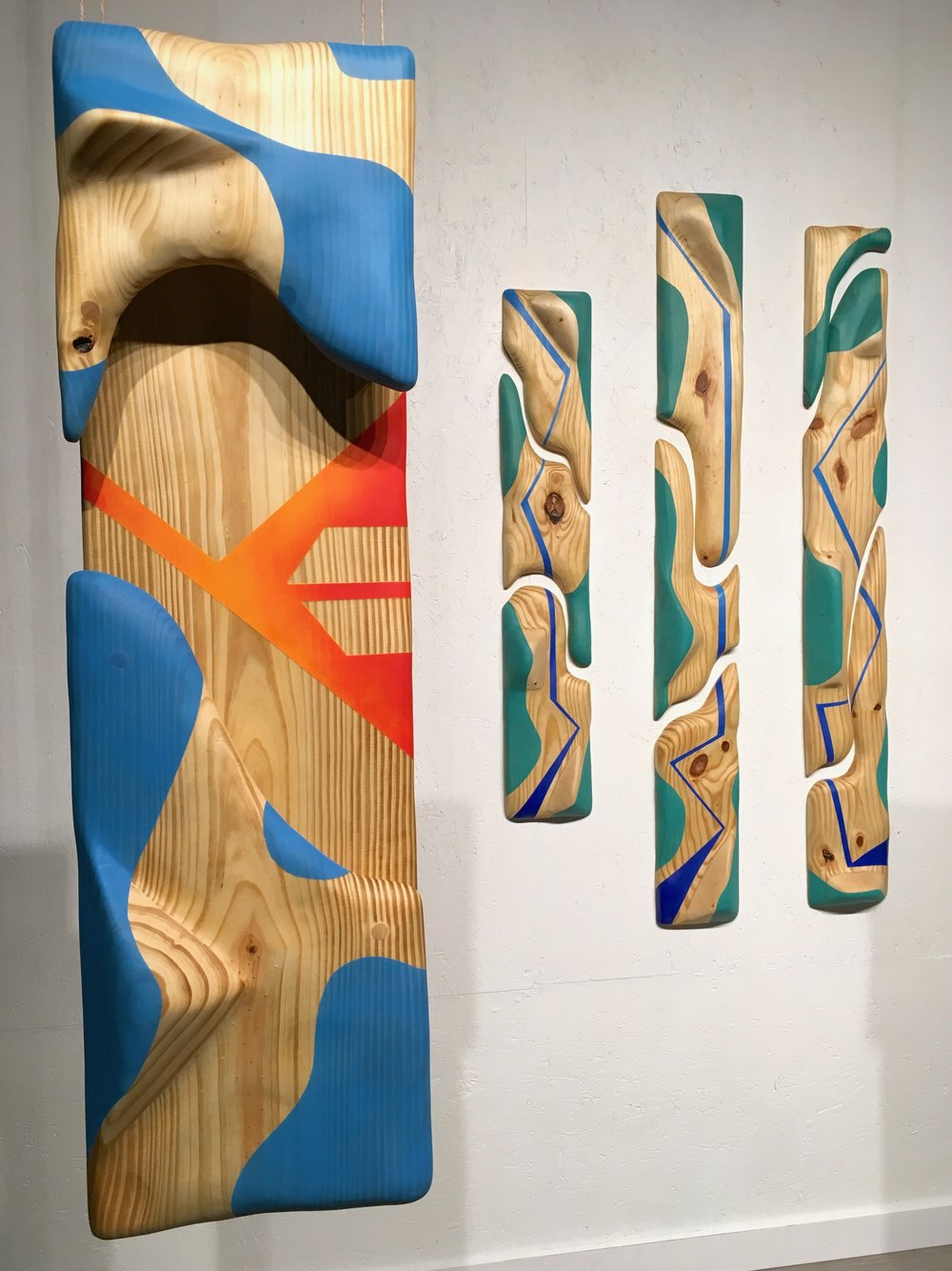 "Sunset: Part 1  (on left), Pine and spray paint, 12"" x 37,"" 2017."