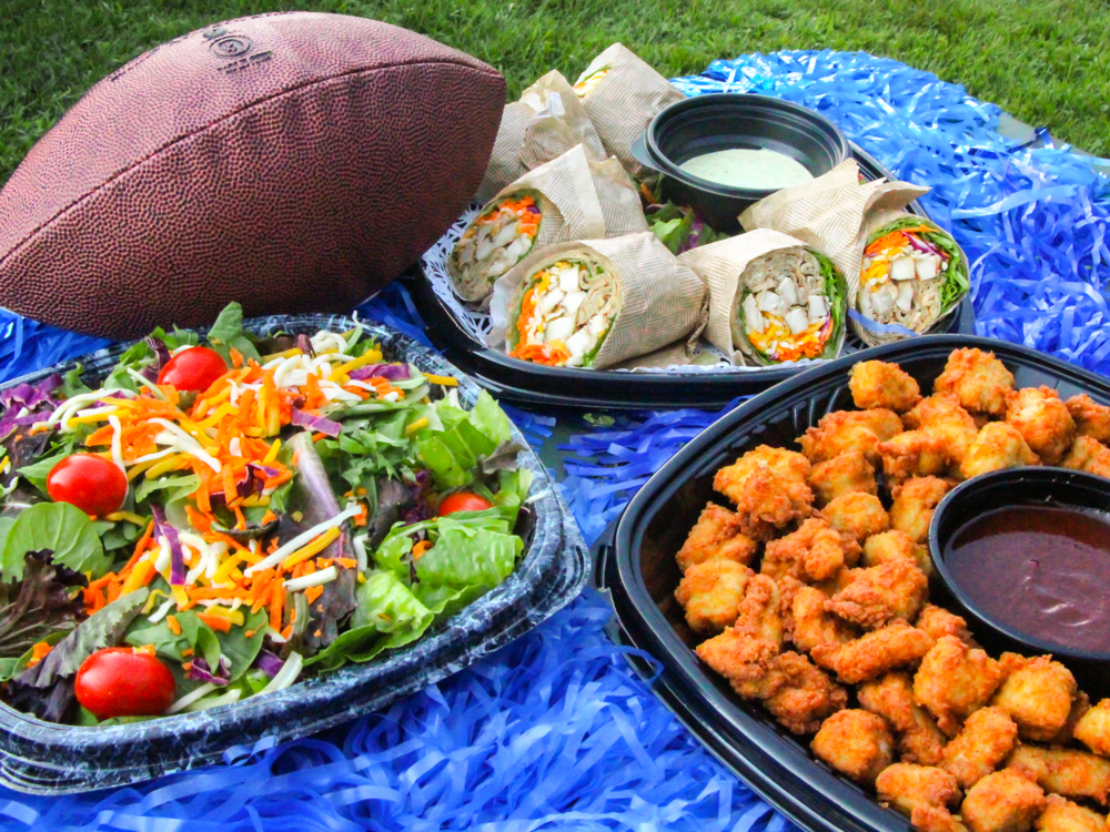 Tailgate with Chick-fil-A... - ...then everyone will be a winner! Enjoy Chick-fil-A Nuggets, Salad and Grilled Chicken Wrap Trays.