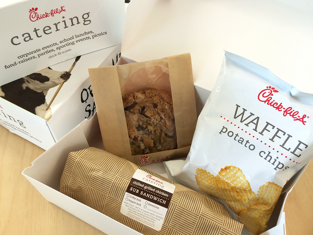 Need to feed a lot of guests at your next event? - We would like to recommend serving our boxed lunch with a Chilled Grilled Sub Sandwich, Waffle Potato Chips and a fresh baked Chocolate Chunk Cookie.
