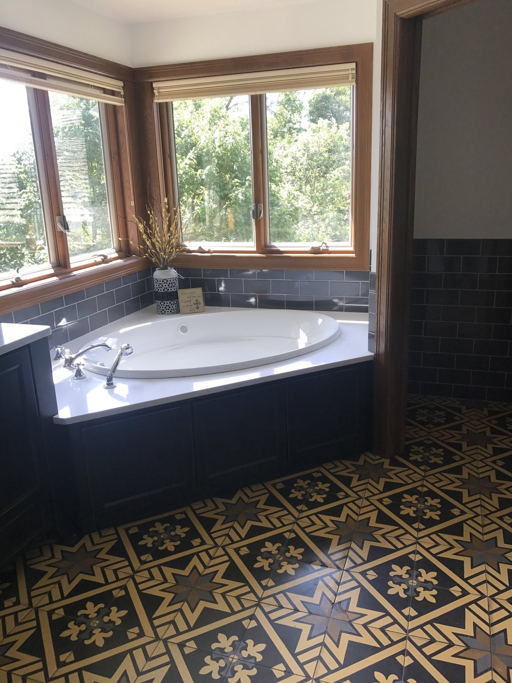 After.. A relaxing and beautiful bath remodel, complete with custom Spanish tile.