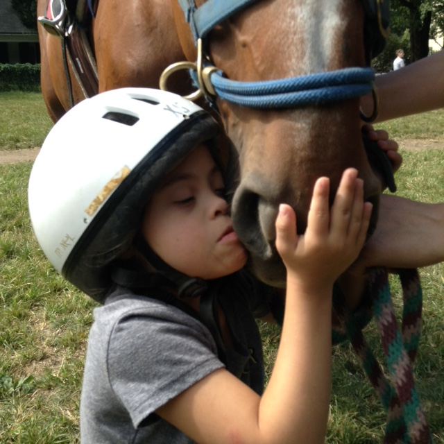 One of my therapeutic riding students shares a moment with her lesson horse.