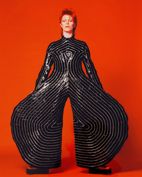 David Bowie in Kansai Yamamoto black-and-white striped patent leather jumpsuit.