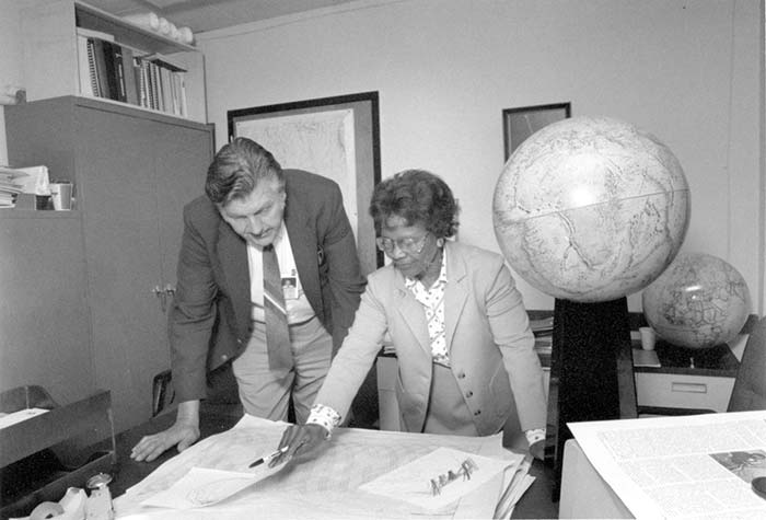 Gladys West, at Dahlgren with Sam Smith in 1985, looks over data from the Global Positioning System she helped develop. (Photo: U.S. Navy)