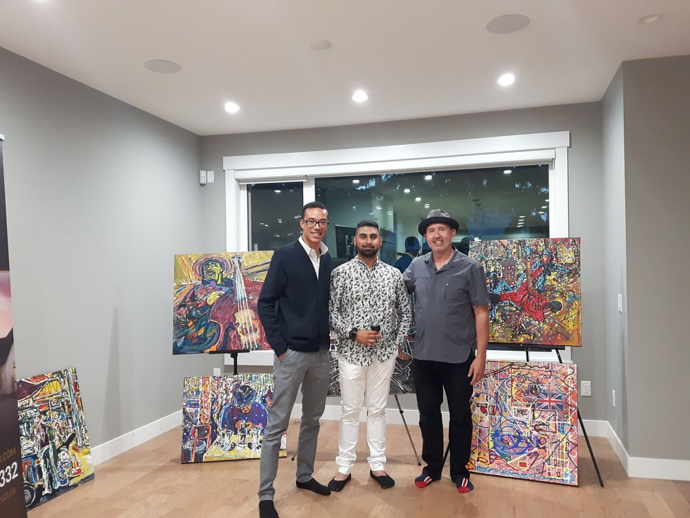 "Vip preview evening July 26, 2018.  Three entrepreneurs, left to right, Ismail,  Harman,  and yours truly (David). Believe it or not, Ismail and Harman are the veterans here.  Thank you  Harmon  for featuring my work in this beautiful home.   Please check out Harman""s listings."