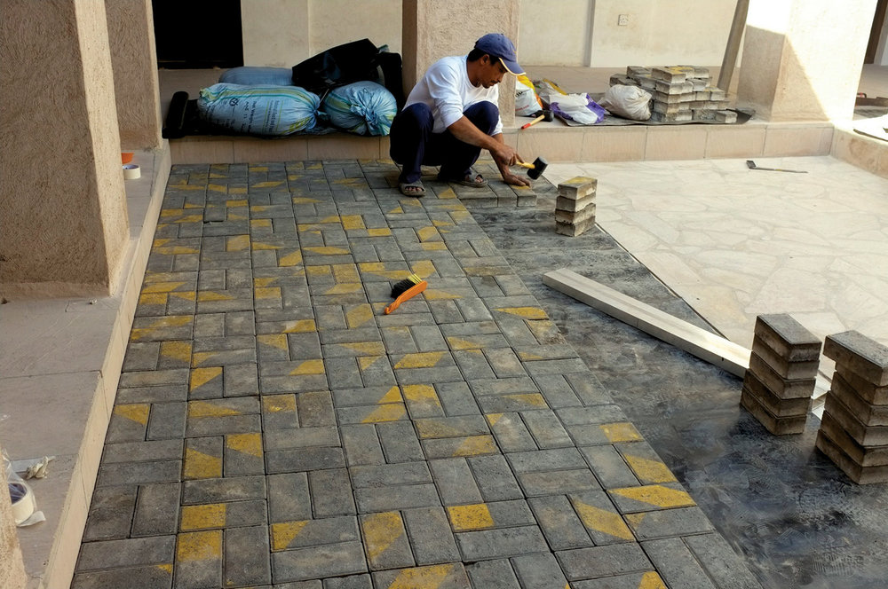 Pavement bricks being installed  Courtyard, House 33, Al Fahidi Historical Neighbourhood, Dubai