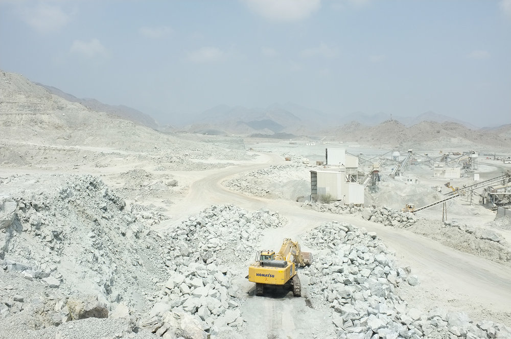 Excavator clearing site after explosion, Quarry, Fujairah  Research image