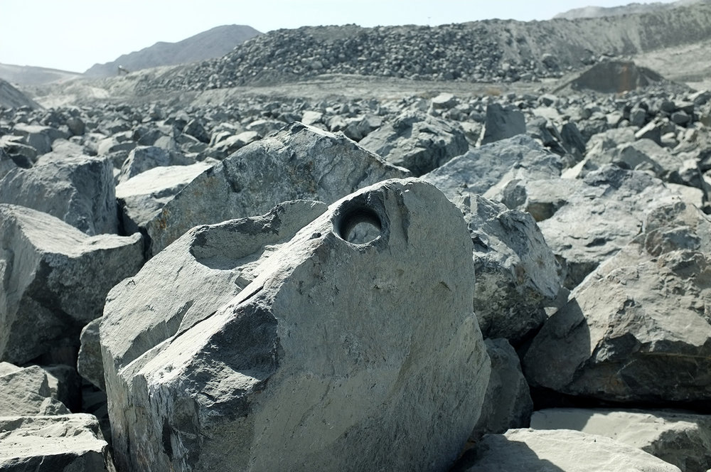 Boulder with hole, Quarry yard, Fujairah  Research image