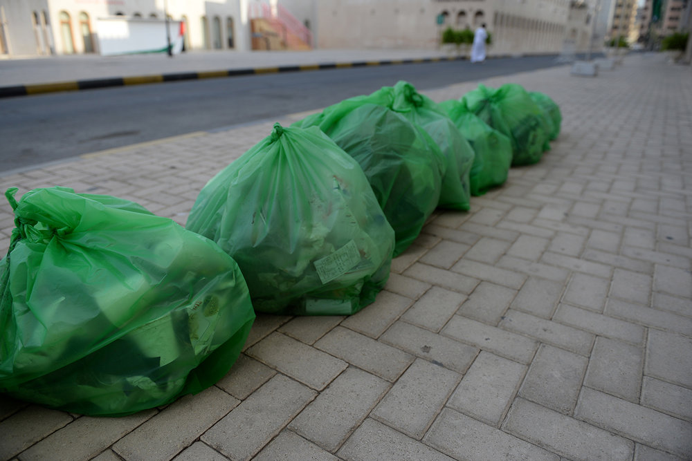 Trash bag on sidewalk alongside Sharjah Art Museum   Al Shuweiheen, Sharjah