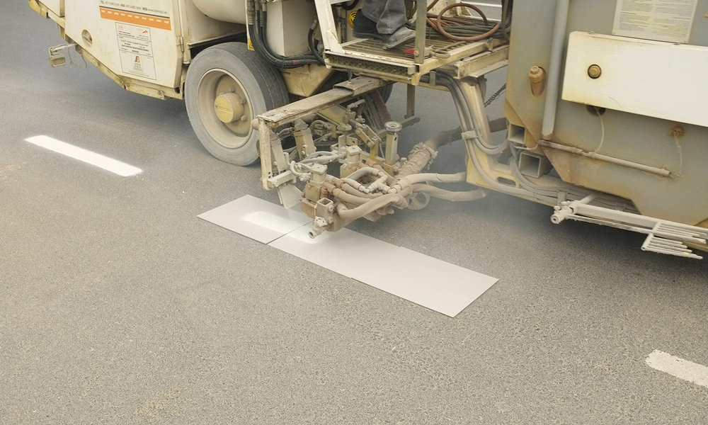 Road Marking ,  2017  Working with crews who maintain road markings in Dubai and Manhattan, paint is applied on grey boards, separating it from the urban substrate, transforming maintenance into formal expression.