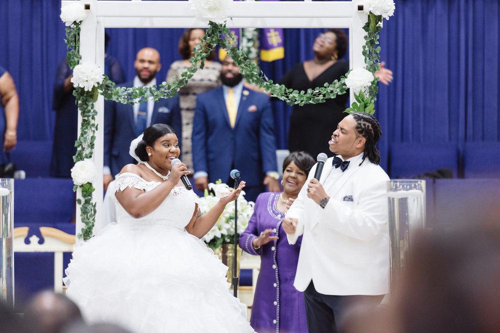 Daja and Jonathan singing at their wedding, 2017