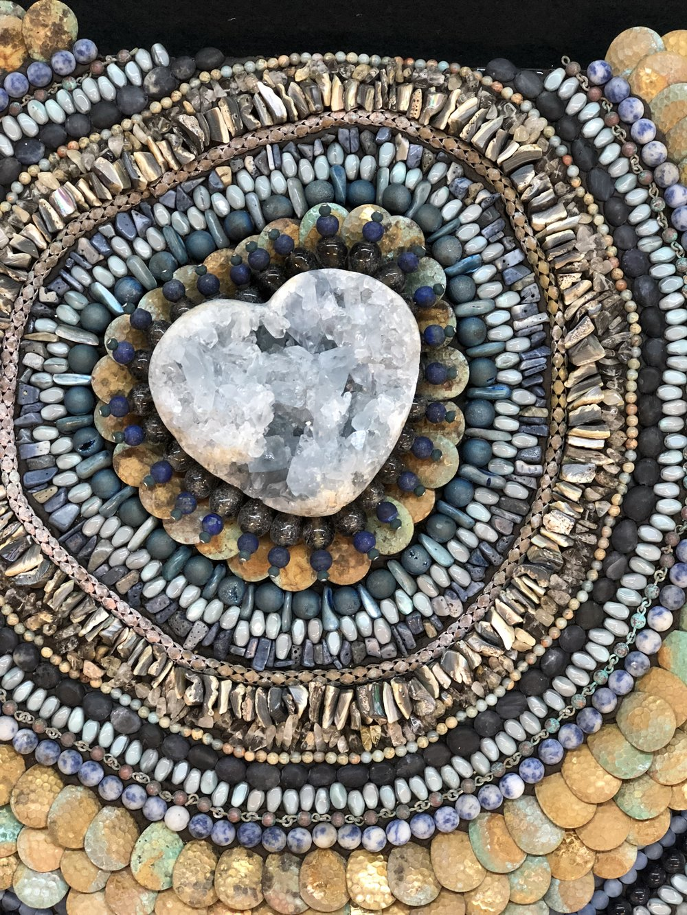 """Loving Blues"" - Using a color palette in rust & blues, I was able to create texture and movement, growing out from the center, by manipulating the scale and direction of the beads."