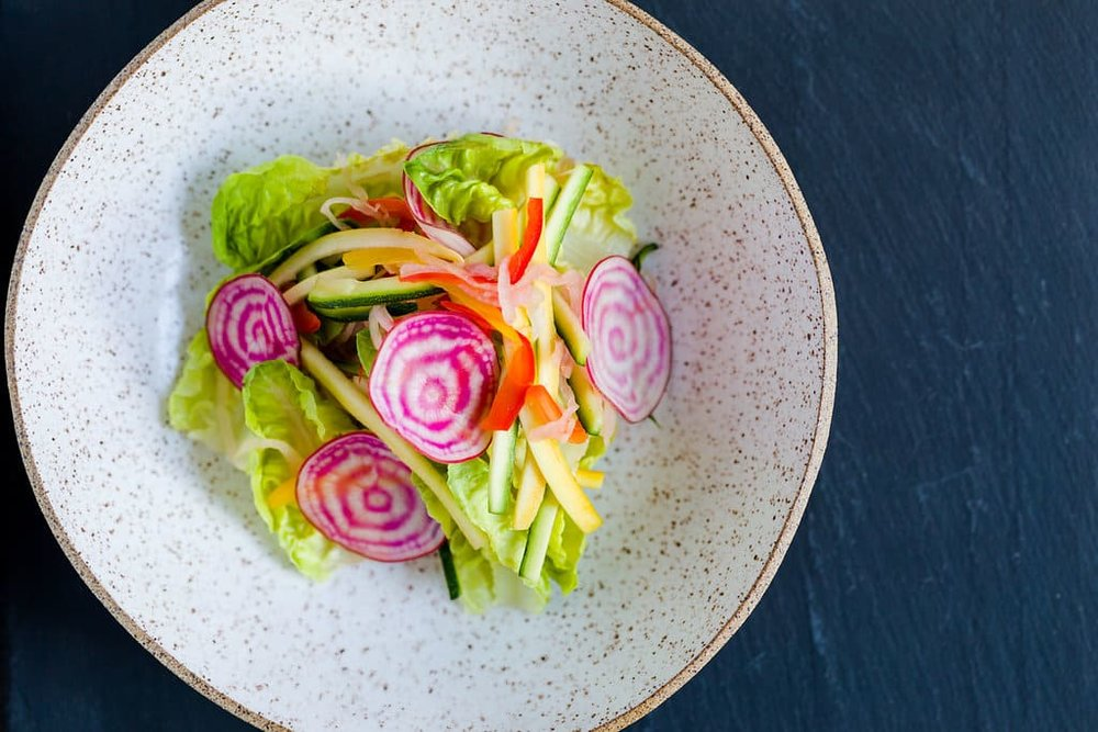 Last Vestige Salad with Gem Lettuce. Pickled Shallots, Cabbage, Zucchini, Squash, Chiogga Beets, Peppers, Tomatoes, Poblano Cream and Toasted Pumpkin Seeds_h.jpg