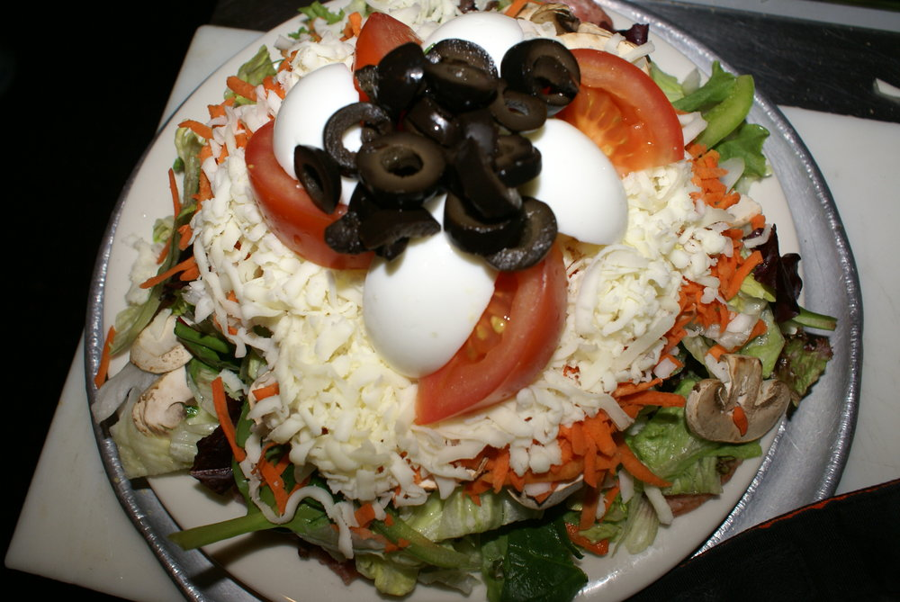 The Mama Salad - Delicious & shareable. Served with House Italian, Blue Cheese, Ranch, or 1000 Island
