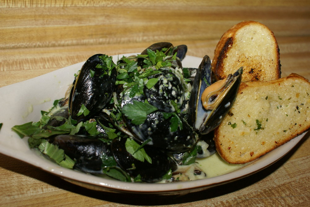 Matteo's Mussels - try them with pancetta! pesto, cream, garlic, shallots, served with crostini