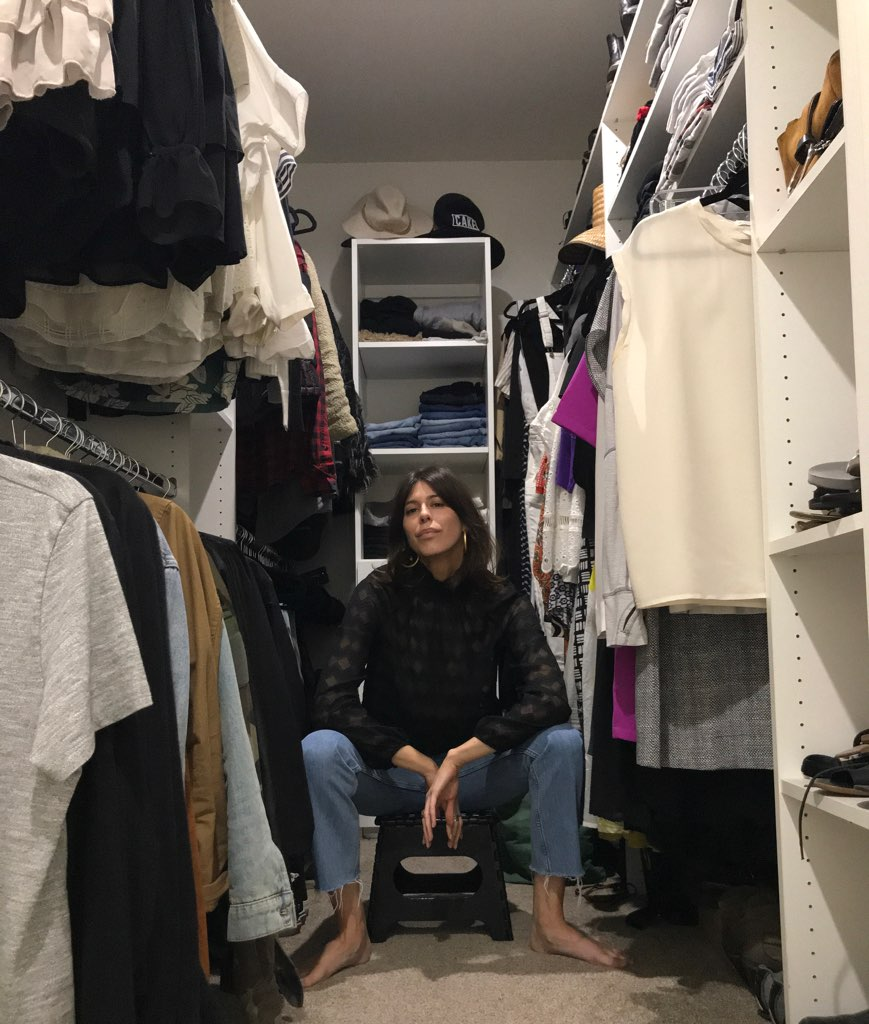 Gabrielle hanging on her closet floor in her go-to items.