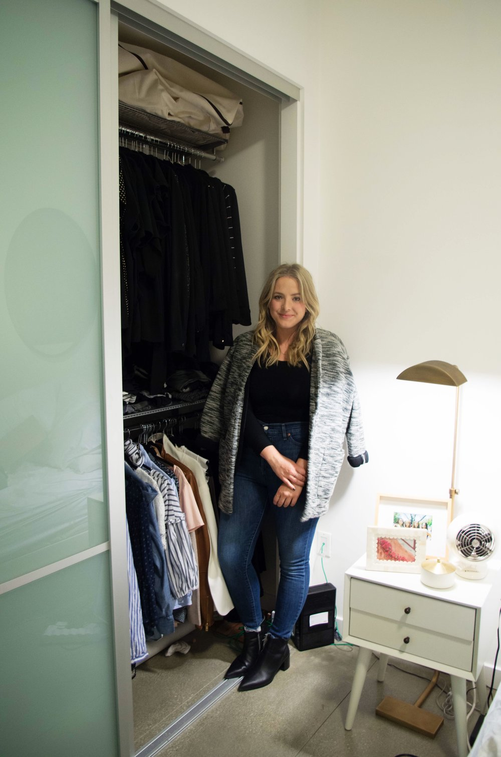 Elise shows me her closet. As I suspected, the black and white overpowered the patterns and stripes. She wears a  Banana Republic  jacket,  Yummie bodysuit ,  Levi's jeans , and  Everlane boots .
