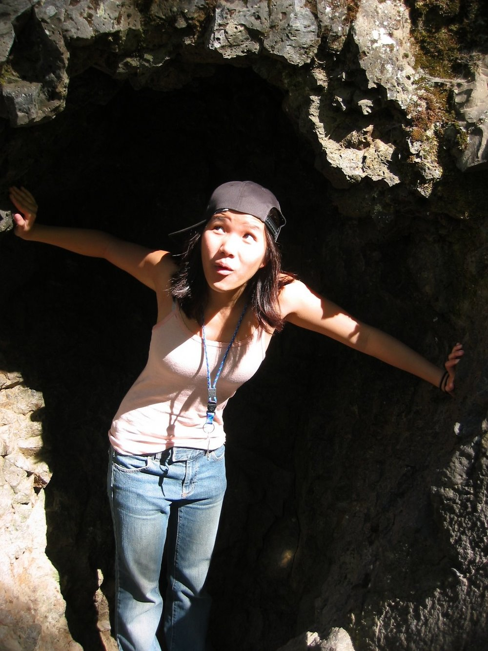 Jena hangs out in a cave in her baggy jeans and sideways baseball cap.