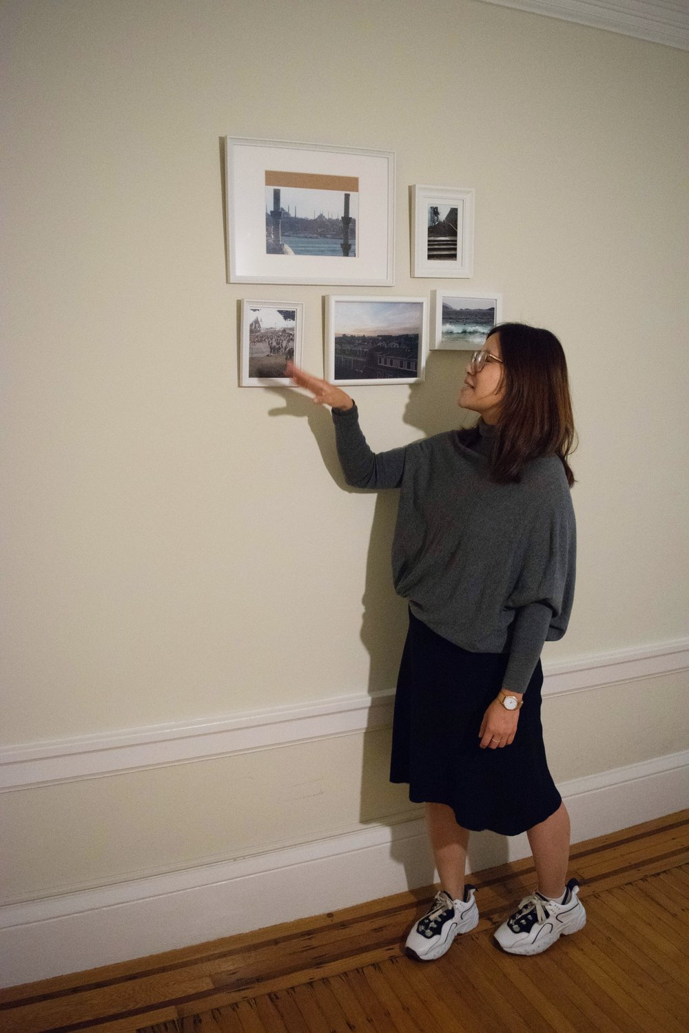 Jena shows some photos of favorite German cities and the cities where she launched Uber. She wears a  Libertine–Libertine  skirt,  Acne Studios  top, and  Acne Studios Manhattan sneakers .