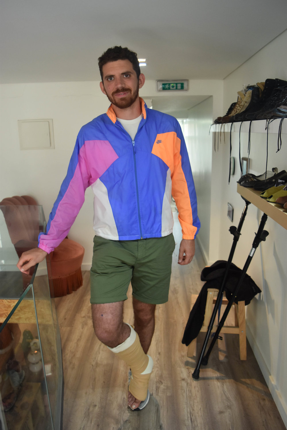 """Chris tore his Achilles before the trip but that won't stop him from getting more attention through a """"look-at-me"""" wind breaker."""