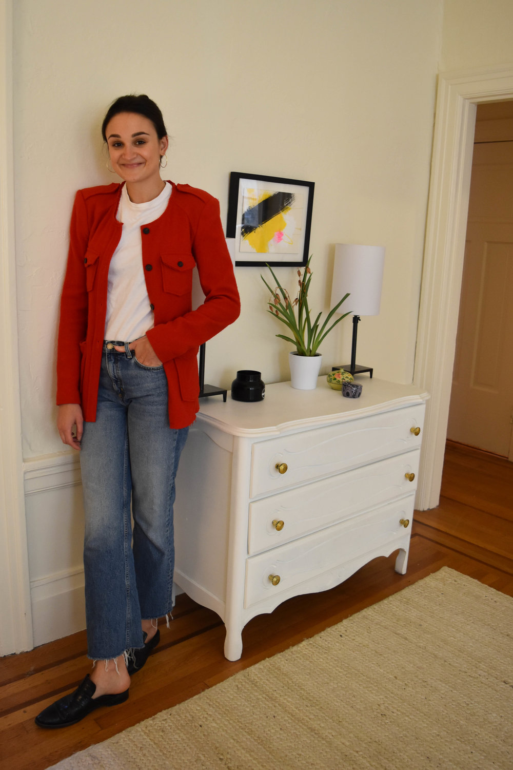 Luckily, Charlotte has a lot of well-edited corners in her apartment for fashion blog photos. She wears a  Hanes x karla shirt ,  & Other Stories jeans ,  Freda Salvador mules , and an  Isabel Marant  jacket.