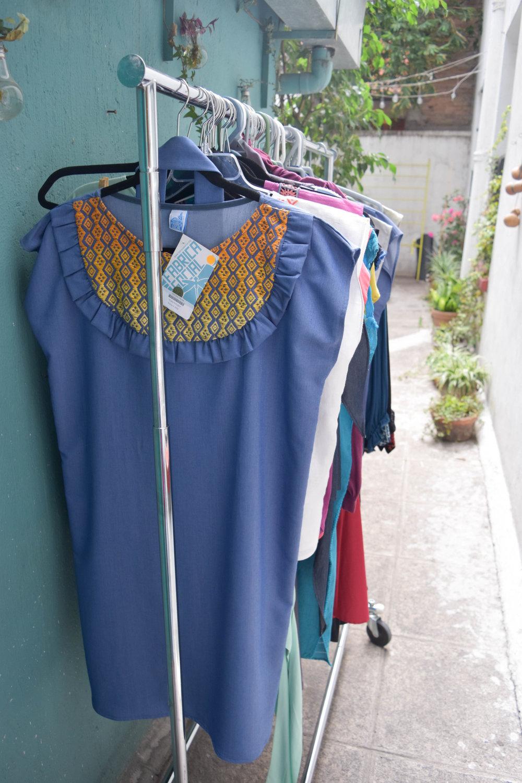 Racks and racks of handmade dresses.