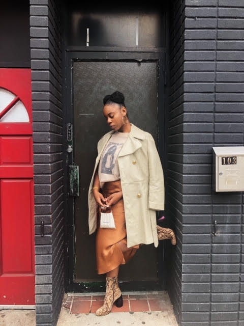 She can put together an outfit. She wears a vintage shirt from  Bad Taste PVD , vintage coat from  Nostalgia PVD ,  Helmut Lang  skirt, and  Dries Van Noten  shoes from  The RealReal .