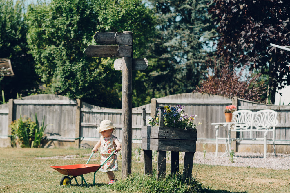 Toddler with wheelbarrow