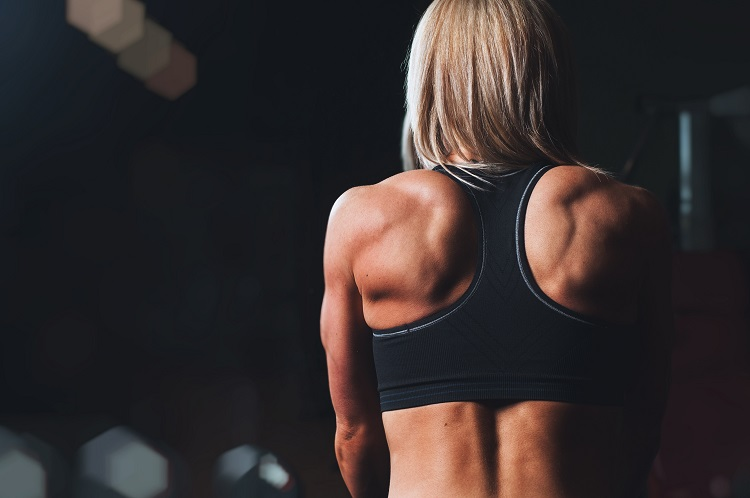 Athletic woman's back