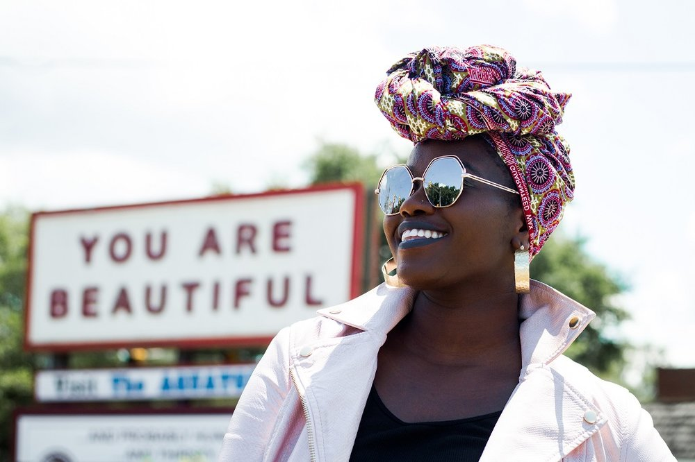 Beautiful woman with african headwrap.jpg
